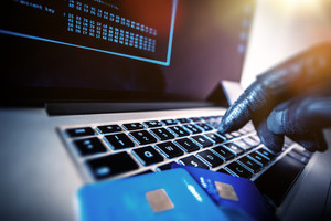 graphicstock-credit-cards-theft-concept-hacker-with-credit-cards-on-his-laptop-using-them-for-unauthorized-shopping-unauthorized-payments_HLlSQ68WD-_thumb